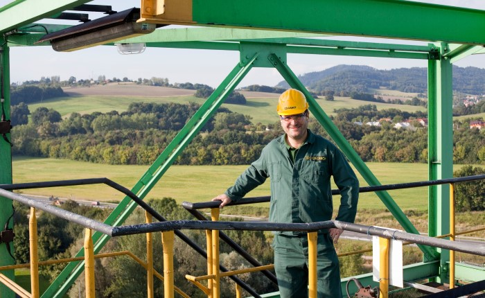 man in hard hat standing on equipment platform